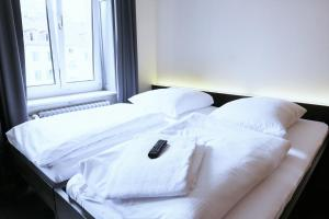 A bed or beds in a room at easyHotel Zürich City Centre