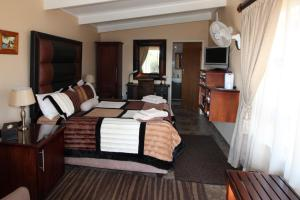 A bed or beds in a room at Waterfront Guest House