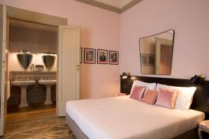 A bed or beds in a room at AdAstra Suites