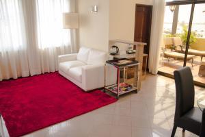 Uma área de estar em Hotel Continental Luanda