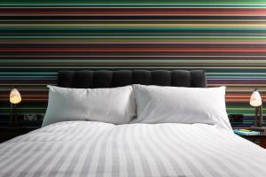 A bed or beds in a room at Village Hotel Leeds South