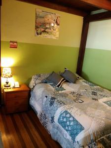 A bed or beds in a room at Hostal Puerta del Sol