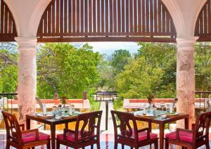 A restaurant or other place to eat at Hacienda Uayamon, a Luxury Collection Hotel, Uayamon