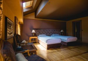 A bed or beds in a room at Ventura Boutique Hotel