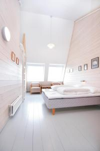 A bed or beds in a room at Turtagrø Hotel