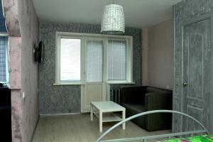 Телевизор и/или развлекательный центр в Apartment on Nikolaya Budy