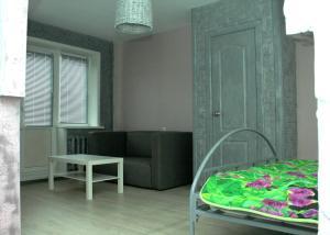Кровать или кровати в номере Apartment on Nikolaya Budy