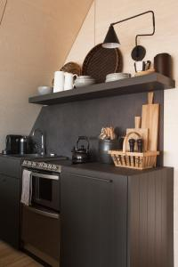 A kitchen or kitchenette at Barn house by the sea