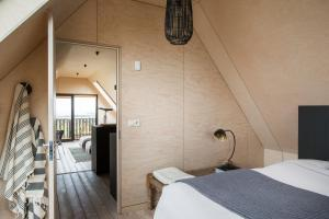 A bed or beds in a room at Barn house by the sea