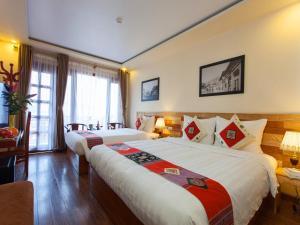 Giường trong phòng chung tại Sapa Centre Hotel