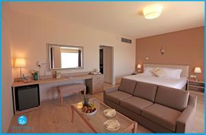 A seating area at Poseidonia Beach Hotel