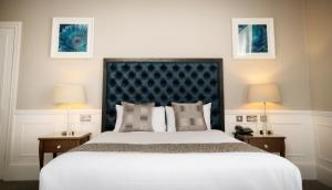 A bed or beds in a room at Steventon House Hotel