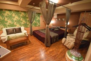 A bed or beds in a room at Nuda by H-Seven (Adult Only)
