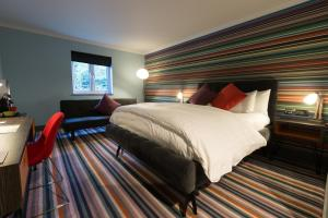 A bed or beds in a room at Village Hotel Newcastle