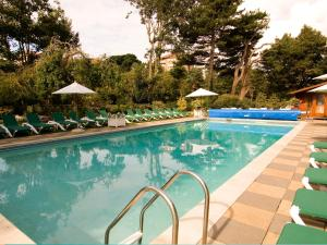 The swimming pool at or near Chine Hotel