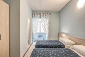A bed or beds in a room at Hotel Nuova Monaco