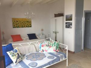 Cama o camas de una habitación en El Laurel