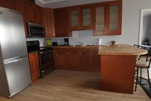 A kitchen or kitchenette at Black Rooster Guesthouse
