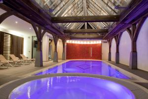 The swimming pool at or near Logis Hotel Le Parc & Spa