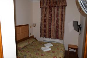 A bed or beds in a room at Leigham Court Hotel