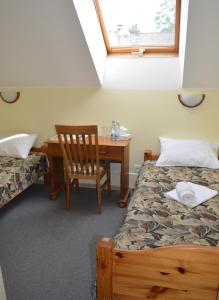 A bed or beds in a room at Hotel Tukums