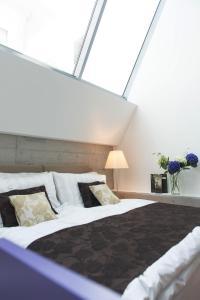 Ein Bett oder Betten in einem Zimmer der Unterkunft Barracuda