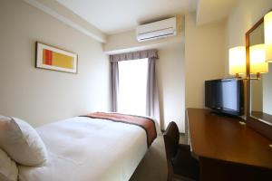 A bed or beds in a room at Hotel Hokke Club Osaka