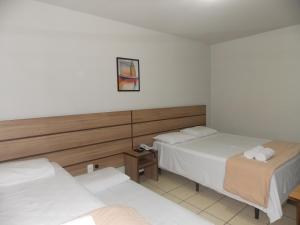 A bed or beds in a room at Hotel Mattes