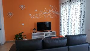 A television and/or entertainment center at Residencial Jandía Marina