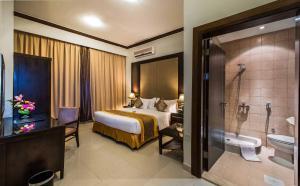 Cama ou camas em um quarto em Boudl Buraydah