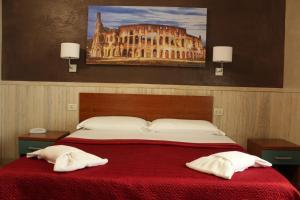 Un ou plusieurs lits dans un hébergement de l'établissement Hotel Pyramid