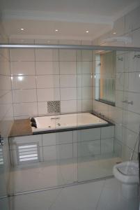 Um banheiro em Hotel Nardy