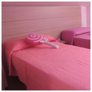 A bed or beds in a room at B&B Melanella