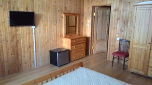 Телевизор и/или развлекательный центр в Гостевой дом Лоза