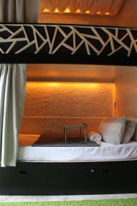 A bed or beds in a room at The Cavern Pod Hotel & Specialty Cafe