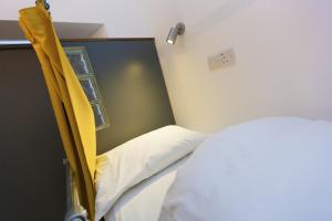 A bed or beds in a room at Cohort Hostel