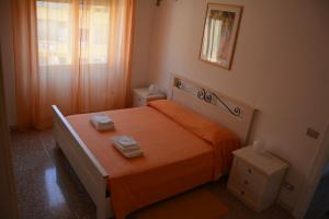 A bed or beds in a room at Andreina a San Pietro Apartment