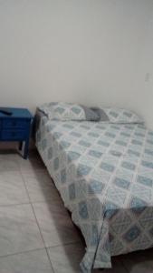A bed or beds in a room at Santa Cruz Apart Hotel