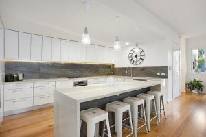 A kitchen or kitchenette at Moonah Beachside Retreat
