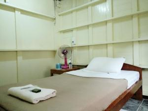 A bed or beds in a room at Lily Guest House