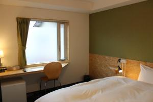 A bed or beds in a room at Nikko Station Hotel 2