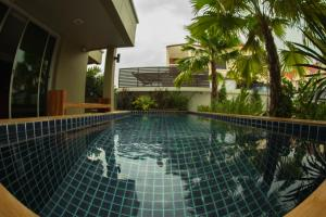 The swimming pool at or close to The Suvarnabhumi Apartment