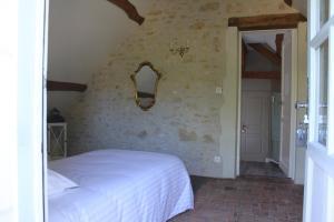 Un ou plusieurs lits dans un hébergement de l'établissement Bella Simonetta
