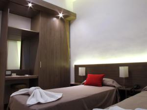 A bed or beds in a room at Hotel Milan