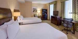 A bed or beds in a room at Hilton Garden Inn Jackson Downtown