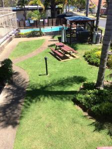 A garden outside Beachfront Apartments