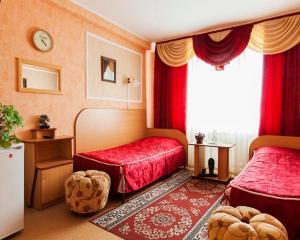 Кровать или кровати в номере Гостиница Оникс