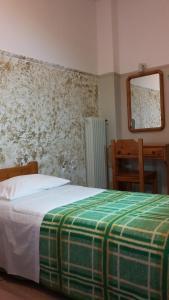 Ένα ή περισσότερα κρεβάτια σε δωμάτιο στο Alma