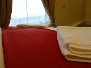 A bed or beds in a room at Trivelles Seaforth