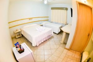 A bed or beds in a room at Hotel Center